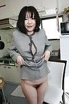 Chinese lady Makiko Nakane lifting up her short skirt and exposing her hirsute love-cage
