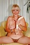 Enormous titted mature shows her slit and plays with a rough implement
