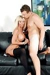 Bosomy fairy-haired cougar Kasey Storm trickling semen from face hole onto massive knockers