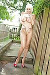 Titsy blond tube adorned lady Jan Burton stretches smooth on top pussy outdoors