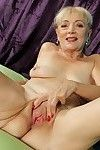 Covered full-grown Janet Lesley revealing saggy apples although undressing