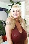 Grimy elderly in underclothes uncovering her jaw-dropping large round milk sacks