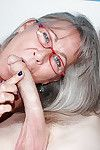 Grey haired ready woman gives a younger stallion a cock stroking this guy won\'t pretty soon forget