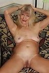 Stunning mature Lisa Cognee teases her skinhead love-cage and arse whereas undressing