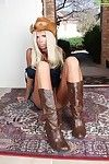 Leggy full-grown blond in cowgirl outfit and boots widening skinhead slit