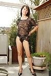 Lusty seasoned hotty Carmen killing off her suit and shorts outdoor