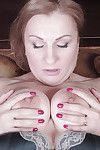 Mellow beauty Dana Karnevali shows her hirsute muff in close up