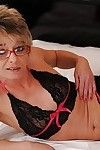 Sexual established in glasses slipping off her sexy pants and expanding her legs