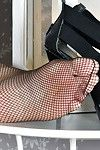 Elderly Euro lady Corazon Del Doll freeing wild feet from mesh