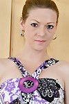 Established redhead Mischelle flashing purple upskirt undies ahead of posing in nature\'s garb