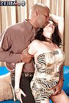 Rita Daniels took off her constricted costume and shows off her colossal bumpers to her slutty ebony lover.