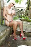 Sassy grown golden-haired in pipe revealing her jugs and bald twat outdoor