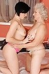 Seductive amateur brown hair is admires fleshly lesbo copulation with a lusty mature