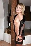 Slender elderly in nylons delightful off her underclothes and toying her fur pie